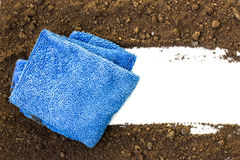 Rag wiping a soil on white Stock Photography