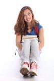 Ragazza adolescente dell'allievo che si siede con i libri di studio Fotografie Stock