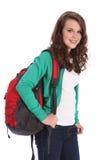 Ragazza adolescente felice del banco con lo zaino rosso Immagini Stock Libere da Diritti