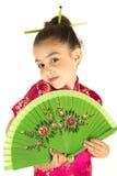 Ragazza adorabile in vestito asiatico che mostra un'espressione timida Immagine Stock Libera da Diritti