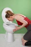 Ragazza affetta da bulimia Fotografie Stock Libere da Diritti