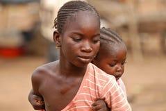 Ragazza africana con il bambino Immagine Stock