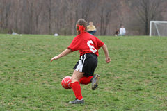 Ragazza al campo di calcio 6 Fotografia Stock
