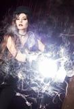 Ragazza con una luce dello studio Fotografia Stock