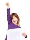 Ragazza allegra che giudica segno in bianco con un braccio sollevato Fotografie Stock