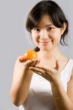 Ragazza arancione Fotografia Stock