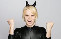 Ragazza arrabbiata con il costume del diavolo Fotografia Stock Libera da Diritti