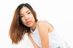 Ragazza asiatica con fondo bianco Immagine Stock