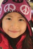 Ragazza asiatica con il cappello di lana Fotografia Stock Libera da Diritti