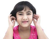 Ragazza asiatica con il trasduttore auricolare Fotografia Stock Libera da Diritti