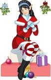 Ragazza asiatica dell'elfo di Natale con il fumetto del vischio Fotografia Stock Libera da Diritti