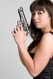 Ragazza asiatica della pistola Immagini Stock
