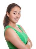 Ragazza asiatica sportiva che sorride a voi Fotografia Stock Libera da Diritti