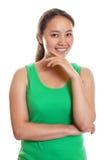 Ragazza asiatica sportiva che sorride a voi Fotografie Stock
