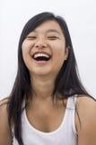 Ragazza asiatica sveglia su fondo isolato Fotografia Stock