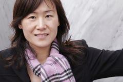 Ragazza asiatica in vestiti di inverno Fotografia Stock Libera da Diritti
