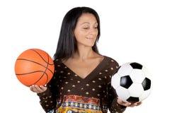 Ragazza attraente con calcio e la sfera del cestino Fotografie Stock