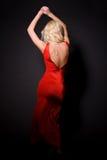 Ragazza attraente in vestito rosso Immagini Stock Libere da Diritti