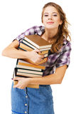 Ragazza bella con una pila di libri Fotografie Stock Libere da Diritti