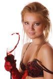 Ragazza bionda sveglia con una spruzzata di vino rosso isolata Fotografia Stock Libera da Diritti