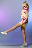 Ragazza bionda in vestito fotografia stock
