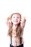 Ragazza in blusa e pantaloni del plaid del cappello di estate con le bretelle Fotografia Stock