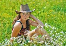 Ragazza in cappello del cowboy Immagine Stock