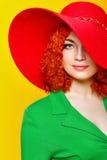 Ragazza in cappello ombreggiato Fotografie Stock