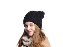 Ragazza in cappotto di inverno, sciarpa e cappello, colpo dello studio, isolato fotografie stock