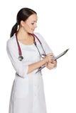 Ragazza in cappotto medico Fotografie Stock Libere da Diritti