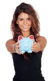 Ragazza casuale con un porcellino salvadanaio blu Fotografia Stock Libera da Diritti