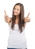 Ragazza casuale felice che mostra i pollici in su Fotografie Stock