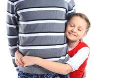 Ragazza che abbraccia suo padre Fotografia Stock