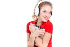 Ragazza che ascolta la musica su un computer della compressa Fotografia Stock