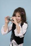 Ragazza che cattura le foto Immagini Stock