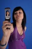 Ragazza che cattura ritratto automatico Fotografia Stock