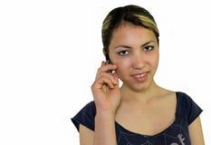 Ragazza che comunica sul mobile Fotografie Stock
