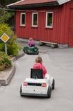 Ragazza che conduce una piccola automobile Fotografia Stock Libera da Diritti