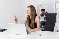 Ragazza che controlla il suo telefono Immagine Stock Libera da Diritti