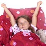 Ragazza che dorme nella base Fotografia Stock