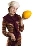 Ragazza che esamina frutta con la disapprovazione immagini stock