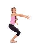 Ragazza che fa esercitazione relativa alla ginnastica Fotografia Stock
