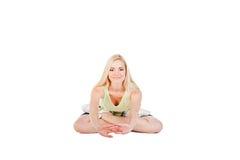 Ragazza che fa esercizio di yoga Immagine Stock