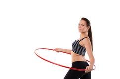 Ragazza che fa hula-hoop Fotografia Stock