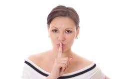 Ragazza che gesturing silenzio isolato su bianco Fotografia Stock Libera da Diritti