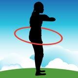 Ragazza che gioca con il hula-hoop Immagini Stock Libere da Diritti