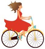 Ragazza che guida una bici Fotografia Stock