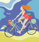 Ragazza che guida una bicicletta Immagine Stock