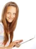 Ragazza che lavora con il computer portatile della compressa Fotografia Stock