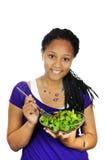 Ragazza che mangia insalata immagine stock libera da diritti